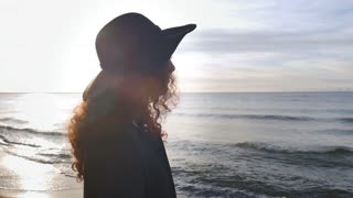 The Girl in the Hat on the Beach