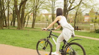 The girl pedaling on a bicycle