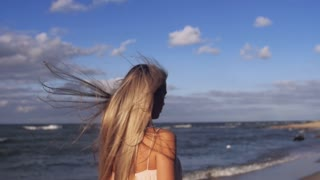 The girl's hair flying in the wind