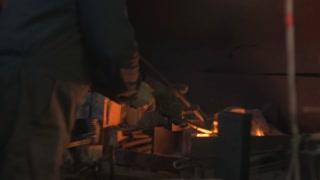 Treatment of hot metal