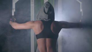 Professional sportswoman trains on the simulator