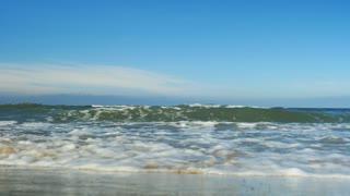 Waves wash ashore
