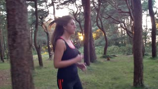 Woman Runs Through the Trees
