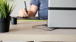 Artist drawing on digital tablet. Close up shot