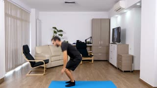 Athletic man exercising at home. Sport in the house