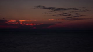 Beautiful gorgeous dramatic timlapse of sunrise, sunset over the sea. Travel and vacation. Fast moving sun and clouds