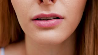 Beautiful mysterious unrecognisable redhead woman biting her lip. Slow motion footage
