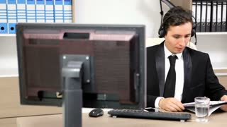 Businessman using headset to talk on the hot line