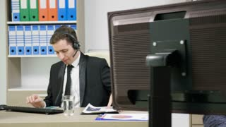 Company workers in suit using headset to talk on the hot line