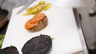 Cook cheking burger meat for cooking. Restaurant cuisine