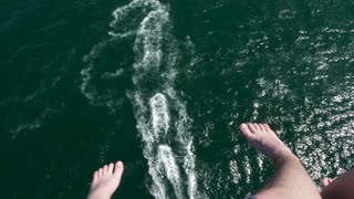 Couple feet over the sea while parasailing. Active vacation