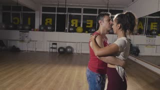 Couple of professional dancers dancing latino bachata dance. Slow motion footage