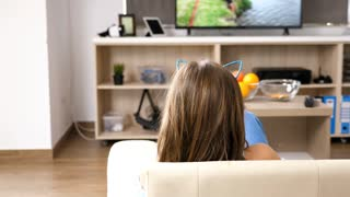 Daughter with her mother are looking at funny videos on the TV. 4K footage