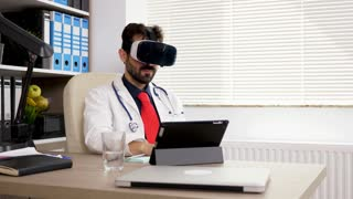 Doctor in his office using a VR virtual reality headset. Future of the medicine. Dolly footage