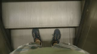 Escalator stairs moving up, pov perspective
