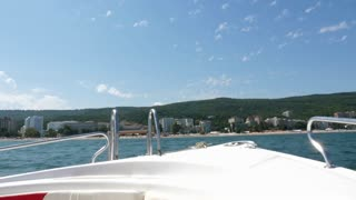 Fron view of a boat in the sea going fast. Active vacation