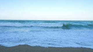 Large view of waves in the sea breaking on the beach