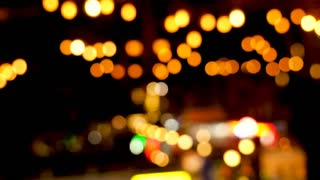 Light bokeh defocused over a dark background. City lights
