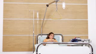 Male doctor visits a child patient in the hospital room