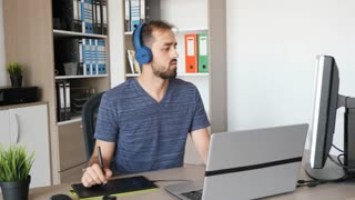 Man working as graphic designer in his modern office