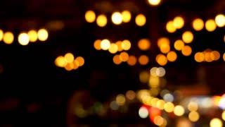 Multiple blurred defocused bokeh lights over a dark backgorund