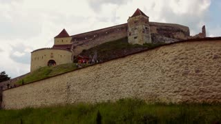 Panoramic panning up on Rasnov Castle, one of Romania's most visited castles