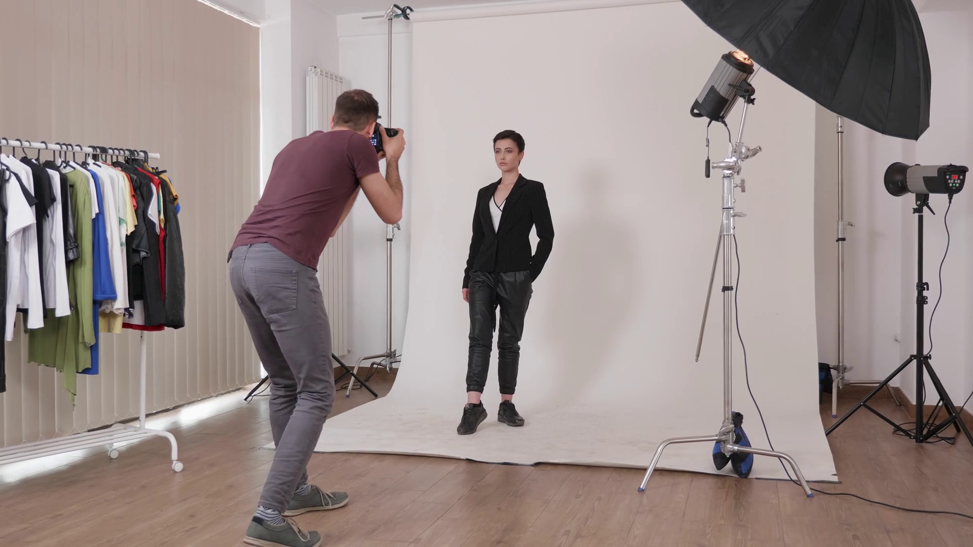 Photographer Taking Pictures Of A Professional Model Backstage Of Fashion Photoshoot In Studio Over A White Background Stock Video Footage Storyblocks