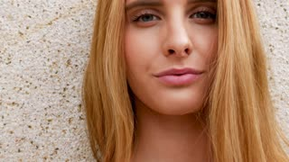Portrait of smiling redhead young woman. Slow motion footage