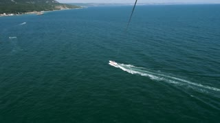 POV aerial parasailig, parascending footage over the sea