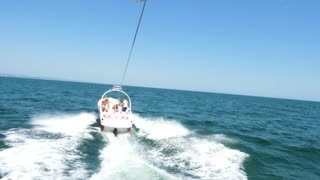 POV footage of parasailing over the sea. Extreme sport. Active holiday