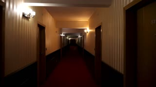 POV footage walking in poorly lit hotel hall. Halloween and terror. Horror and scary
