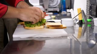 Preparing a sandwich in resturant kitchen. Close up slow motion footage
