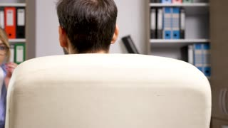 Rack focus on woman from human resource department interviews a potential employee in the office. Dolly slide 4K footage