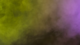 Rich and dense abstract colorful smoke clouds over a black background
