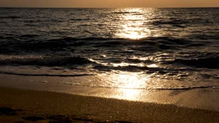 Scenic landscape of sun rays refection on the water at the sunrise. Slow motion footage