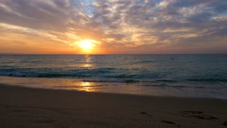 Scenic sunrise over the sea on the beach. Beautiful landscape. Travel and vacation