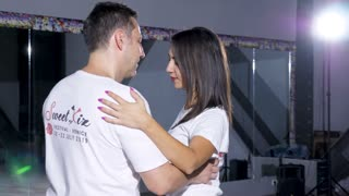 Sensual and sexy couple dancing together in big empty room. Sport and healthy lifestyle