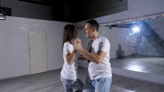 Sexy and sensual professional dancers dancing in big empty room. Healthy lifestyle