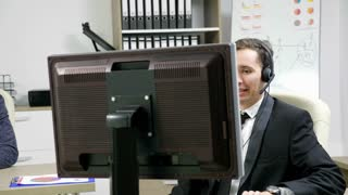 Telemarketing operator using headset to talk on the hot line