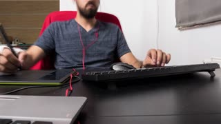 Time lapse view of graphic designer man working in his office. Professional artist using a digital tablet