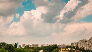 Timelapse of fast moving clouds over a residential area in the city
