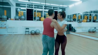 Two professional dancers dancing in a hall. Classical latino dance