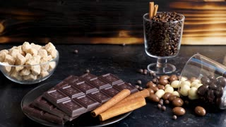 Yummy sweets and candies of different type on a wooden background