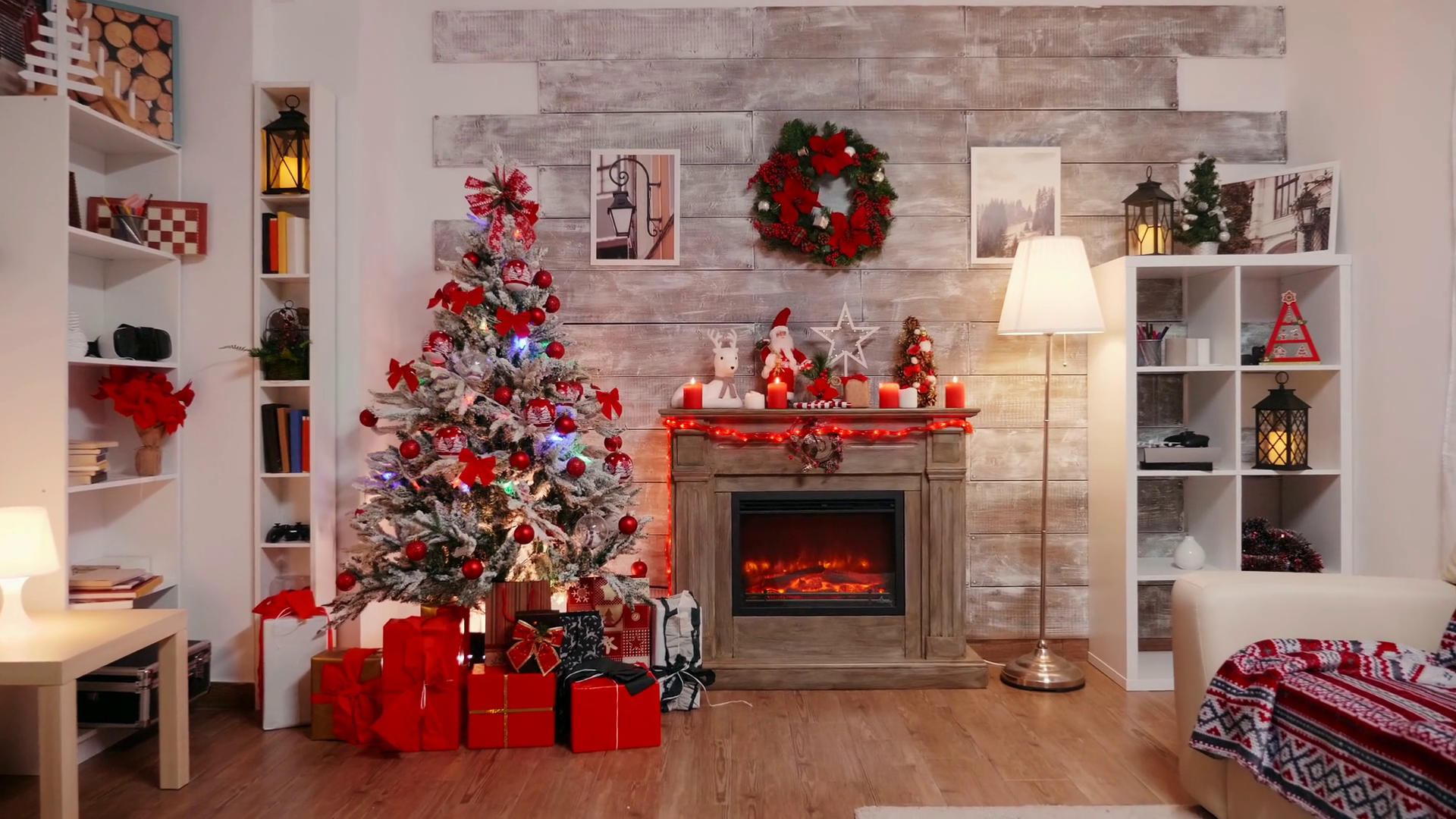 Zoom in shot of fireplace burning in a room decorated for ...