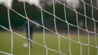 Close up view of a football net, the football gates being hit with the ball. Championship, energetic game. Having fun, leisure time, hobby.