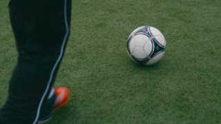 Close up view of a soccer ball being hit by player aiming to the gates, the goalkeeper misses the ball, it flies into the gates, goal. Failing the match, losing the game. Winning the match, victory.