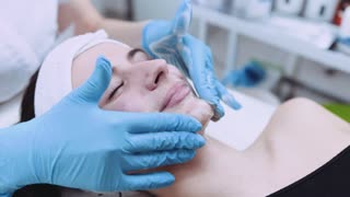 Close up view of beautiful female face having plastic massage by beautician. Health care, skin care. Lifting procedure, correction. Being young and beautiful, therapeutic activities.