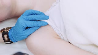 Professional dermatologist takes photo of the mole, birthmark for medical examination. Close up view of the camera in doctor's hands, and the screen of the cam. Bodycare, stay healthy.