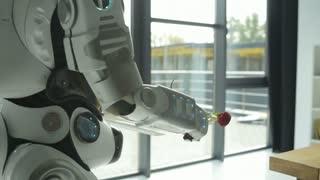 Careful robotic machine brining breakfast for woman