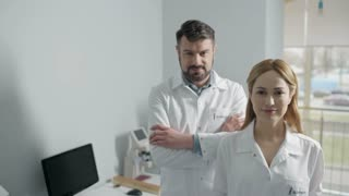 Cheerful doctors standing in office